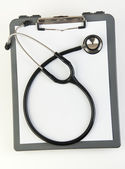Stethoscope and health chart — Stock Photo