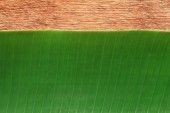 Banana leaf on the wooden board — Stock Photo