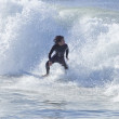 Athlete surfing on Santa Cruz beach in California — Stock Photo #59007595