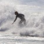 Athlete surfing on Santa Cruz beach in California — Stock Photo #59009109
