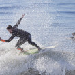 Athlete surfing on Santa Cruz beach in California — Stock Photo #59013231
