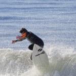Athlete surfing on Santa Cruz beach in California — Stock Photo #59013253