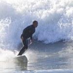 Athlete surfing on Santa Cruz beach in California — Stock Photo #59013301
