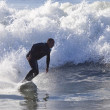 Athlete surfing on Santa Cruz beach in California — Stock Photo #59013367