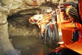 Heavy machine inside a mine shaft — Stock Photo