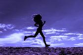 Silhouette of a girl runner effect films — Stock Photo