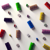 A selection of coloured spools and bobbins of thread — Stock Photo