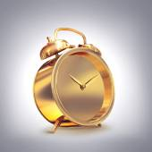 Golden old fashioned  alarm clock on grey  background. — Stockfoto