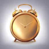 Golden old fashioned  alarm clock on grey  background. — Stock Photo