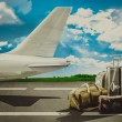 Travel bags in airport and airliner. Concept — Stock Photo #76283771