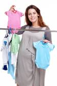 Pregnant woman shopping for a baby — Stock Photo