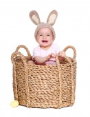 Baby wearing  rabbit hat sitting in a basket — Stock Photo