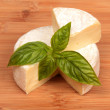 Brie cheese with a basil — Stock Photo #53566999