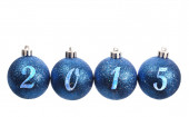 Four blue spangled christmas balls arranged in the year 2015 — Stock Photo