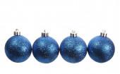 Four blue spangled christmas balls — Stock Photo