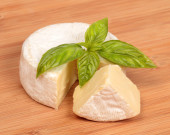 Brie cheese with a basil — Stock Photo
