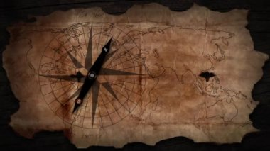 Old map with a compass needle — Wideo stockowe