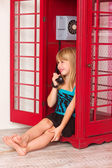 Girl calling in red a phone — Stock Photo