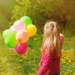 Little  girl Turned back with balloons — Stock Photo #71830233