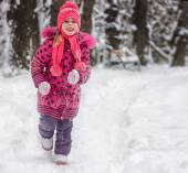 Happy 5 year old girl running on snow — Stock Photo