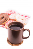 Hot cup of coffee and tasty donuts  — Stock fotografie