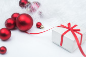 Christmas red gift box with balls — Stock Photo