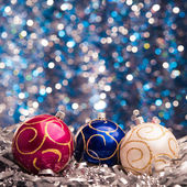 Three christmas balls on background — Stock Photo