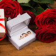 Romantic red roses with golden rings — Stock Photo #62187541