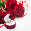 Romantic red roses with wedding rings — Stock Photo #63349233