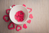 Romantic white cup with red hearts — Stock Photo