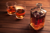 Glass and bottle with whiskey — Stock Photo