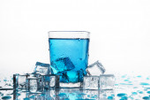 Water glass and cold ice cubes — Stock Photo