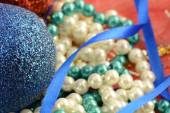 Christmas background with blue and white pearls — Photo