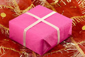 Red gift box with white ribbon bow — Stock Photo