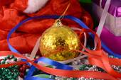 Christmas background with gift box, diamonds, new year balls — Stock Photo
