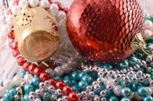 Beautiful ornaments, champagne, pearl and balls as a New Year decoration — Foto Stock