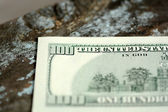 Hundreds of US dollars on old wooden background — Stock Photo