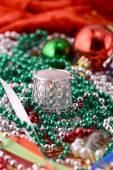 Christmas decorations, new year invitation card, drums, pearls and xmas balls — Stock Photo