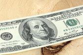 One hundred dollars banknotes on wooden background — Stock fotografie