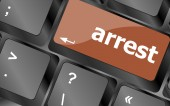 Arrest word on computer pc keyboard key — Stock Photo