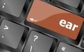 Ear button on computer pc keyboard key — Stock Photo