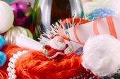 Christmas background with wine bottle pearls and santa claus — Stock Photo