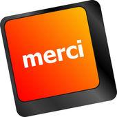 Thank you (merci) word on computer keyboard key — Stock Photo