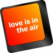 Modern keyboard with love is in the air text — Stock Photo