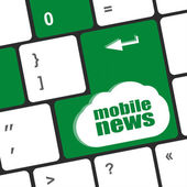 Mobile news word on black keyboard and green button — Stock Photo