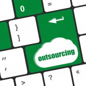 Outsourcing button on computer keyboard key — Stock Photo