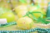 Easter background with eggs, ribbons and spring decoration — Stock Photo