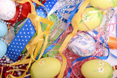 Easter background with eggs, ribbons and spring decoration — Fotografia Stock