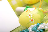 Easter background with eggs and gift box — Stock Photo