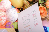 Easter setting with gift box and spring decoration — Stock Photo